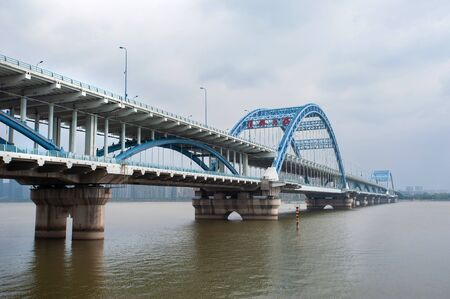 Fuxing Bridge on the Qiantang River, Hanghzou, China. The sign on the bridge reads Fuxing Big Bridge in traditional Chinese.