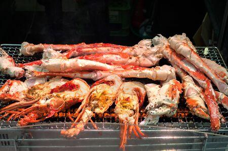 Grilled shrimp and crabs at Kuromon Ichiba Market, Osaka, Japan