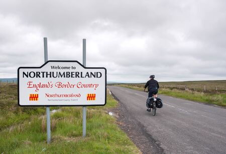 Male cyclist entering Northumberland on the Coast to Coast trail, UK Editorial