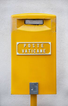 Traditional yellow postbox at the Vatican City, Rome, Italy