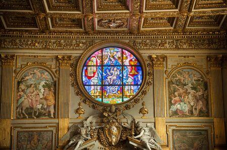Ornate stained glass window by Giovanni Hajnal (1995) at Basilica Papale di Santa Maria Maggiore, Rome