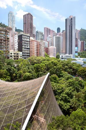 View of mid-levels and the Edward Youde Aviary from Hong Kong Park