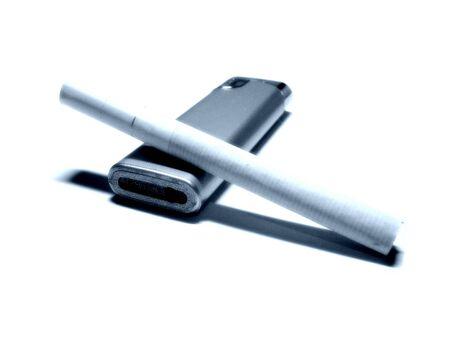 white cigarette and steel lighter over white background photo