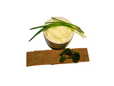 mayonnaise with green leaves onion over white background photo
