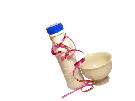 holiday bottle of yoghurt with white cup and pink ribbon Stock Photo