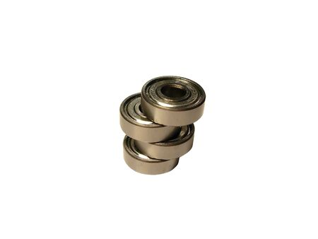 chock: metal bearing pile over white background, spares part Stock Photo