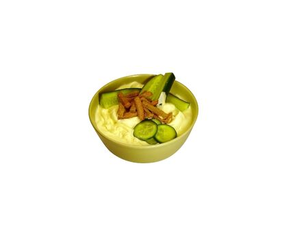 plateful: plateful mayonnaise, peaces of cucumbers and dried breads                                Stock Photo