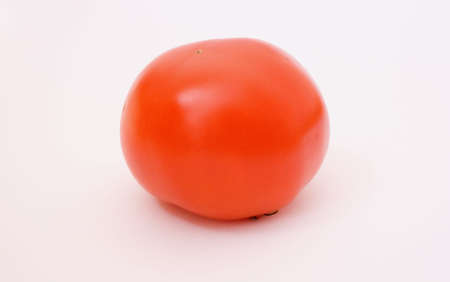 macrophotography: one red tomato over white background, macrophotography Stock Photo