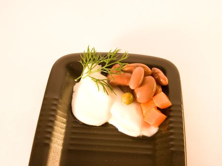 plater: mayonnaise with beans on black plater over white background