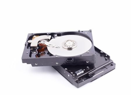 computer parts: Hard disk drive with metal cover removed   Stock Photo