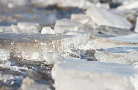 thawing: Thawing pieces ice in cold water close-up   Stock Photo