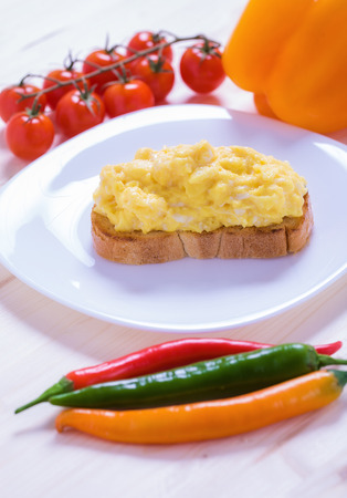 scrambled eggs: English style scrambled eggs on toast with vegetables