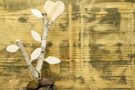 co2 neutral: Background made of spruce wood with Birch Wood and wooden heart - symbolic of the growing love