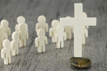 christian community: Meeting prior to a cross as a symbol of the Christian community
