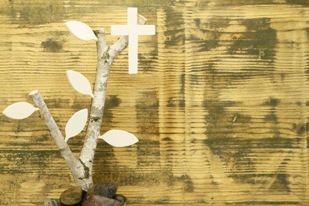 birchwood: Background of used wood with birchwood and wooden cross.