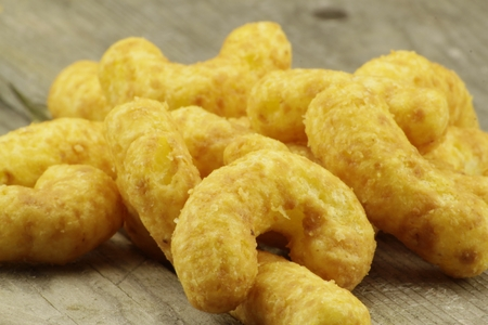 nibbles: Tasty nibbles with golden peanut puffs Stock Photo