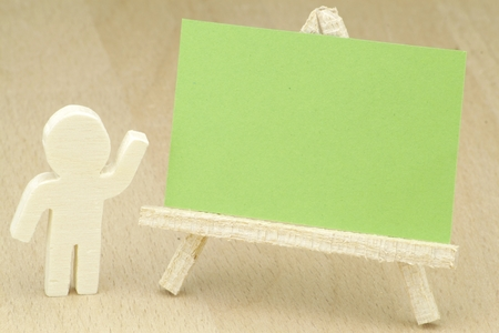 wooden figure: Green blackboard presented by and with a wooden figure