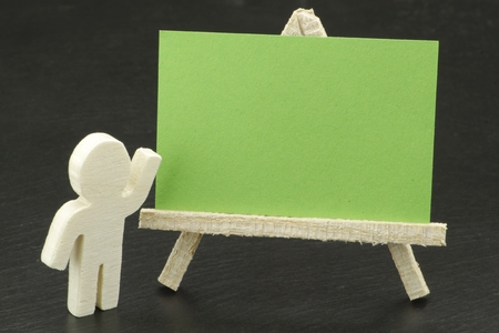 A nice figure with empty card Stock Photo