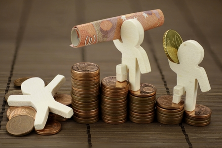 Symbolic representation with wooden figures from financial rise and fall