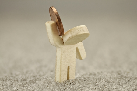 Wooden figure with cents