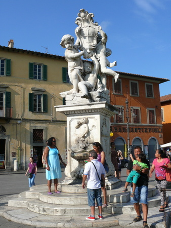 Pisa, Italy, August 2, 2014: Statue in the Square of Miracles surrounded by people in Pisa