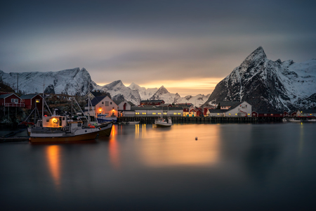 rorbu: Hamn�y village rorbu and boats with mountains in the backround at sunset, Lofoten