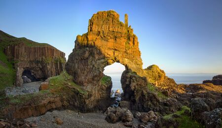 mull: Carsaig Arches - rocks formation in sunset light, Isle of Mull, Scotland