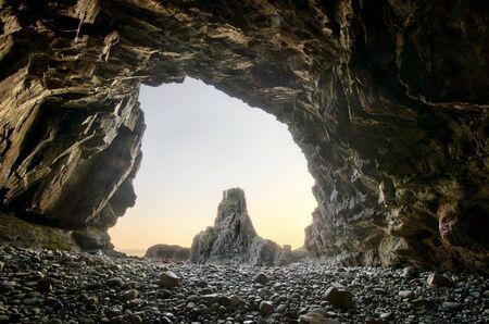 mull: Carsaig Arches rocks formation captured from inside cave, Isle of Mull, Scotland