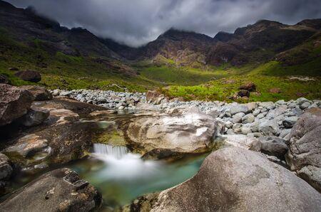 skye: Coruisk River among cloudy Black Cuillins mountains, Isle of Skye, Scotland