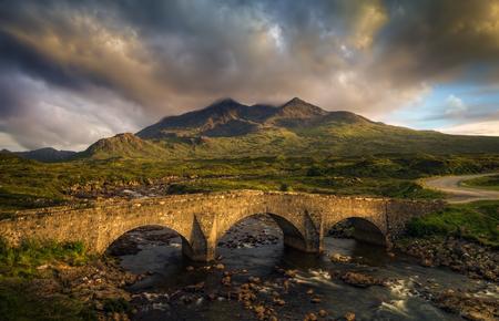 Sligachan Bridge and cloudy Black Cuillins in sunset light, Isle of Skye, Scotland