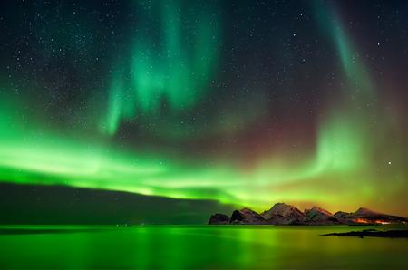 Aurora Borealis at Flaget coastline, Lofoten Фото со стока