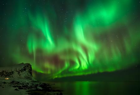 Great Aurora Borealis over Myrland village, Lofoten