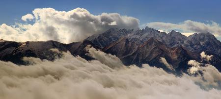 below: Panorama of Tatra mountains under and below clouds, Poland Stock Photo