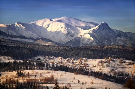 giewont: Winter Tatra mountains and Jurgow village in sunset light, Poland