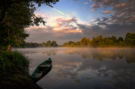 narew: Fishing boat at Narew river in sunrise light, Poland
