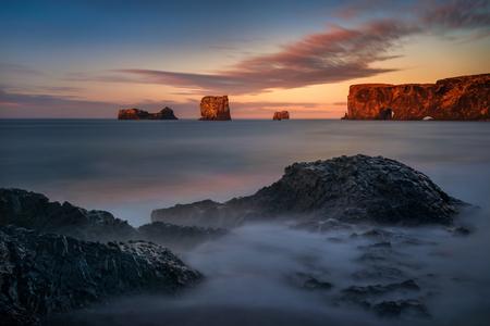 Rocks of Dyrholaey black beach in sunrise light, Iceland