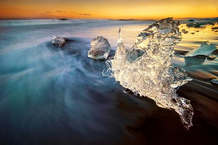 Iceberg in shape of a swan on Jokulsarlon beach, Iceland Stock Photo