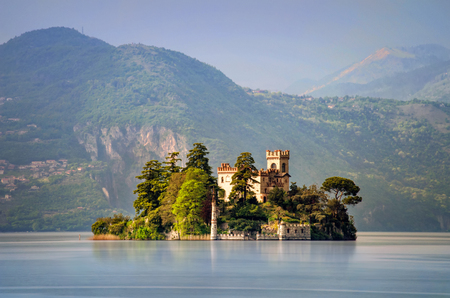 Isola di Loreto on Lake Iseo with mountains in background, Italy Stock Photo