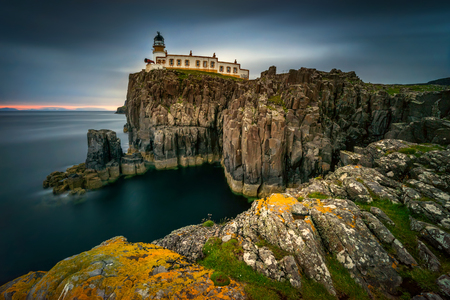 Lighthouse on Neist Point cliffs, Isle of Skye, Scotland Stok Fotoğraf