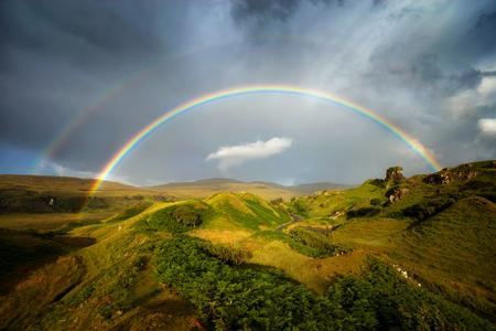 Rainbow over Fairy Glen hills, Isle of Skye, Scotland Stock Photo