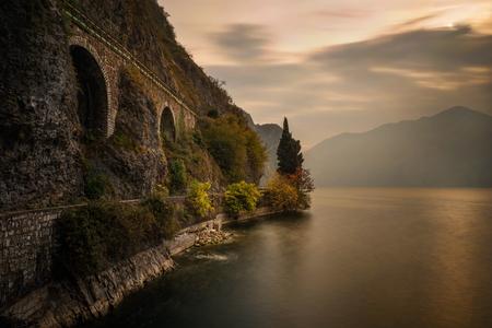 Bike road around Iseo Lake under railroad bridge, Italy  Stockfoto