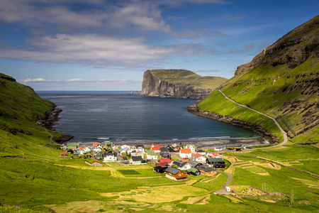 Tjornuvik village and cliffs behind in sunny weather, Faroe Islands 写真素材