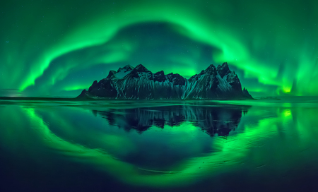 Aurora reflections on Stokksnes black beach with Vestrahorn mountains in center, Iceland
