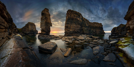 Panorama of Noss Head rock formations in sunset light, east coast of Scotland