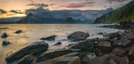 Rocky coast of Loch Scavaig with Cuillin Mountains on sunset, Isle of Skye, Scotland