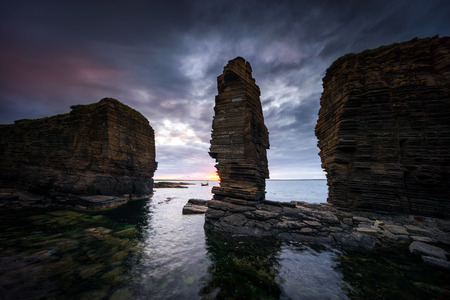 Noss Head rock formations in sunset light, east coast of Scotland 版權商用圖片