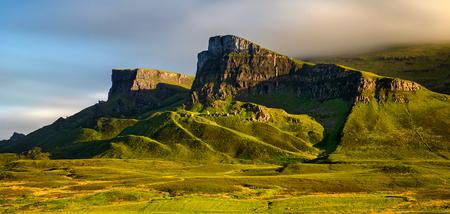 Rocks of Quiraing group at Trotternish Ridge in sunset light, Isle of Skye, Scotland Фото со стока