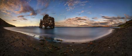 Sunset on black beach around Hvitserkur rock formation, Iceland Фото со стока