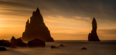 Panorama of colorful sunrise on coastline of Reynisfjara black beach, Iceland