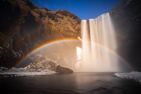 Rainbow at Skogafoss waterfall in winter, Iceland